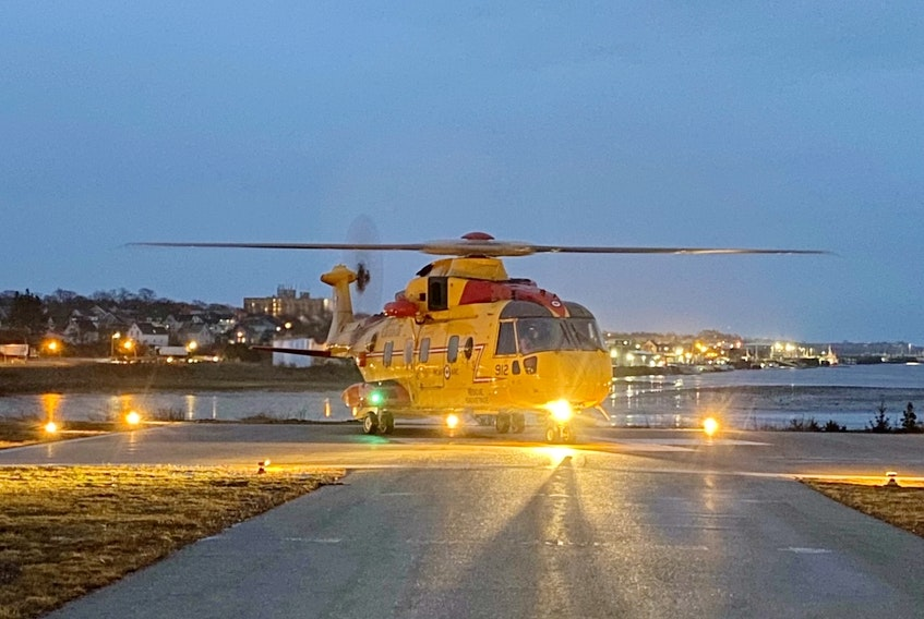 A Cormorant helicopter touches down at the Yarmouth Hospital helipad with a person requiring medical assistance.