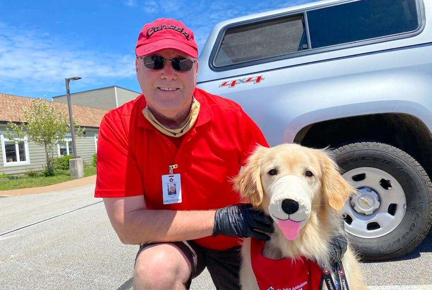Dan Fleck and therapy dog Walt.