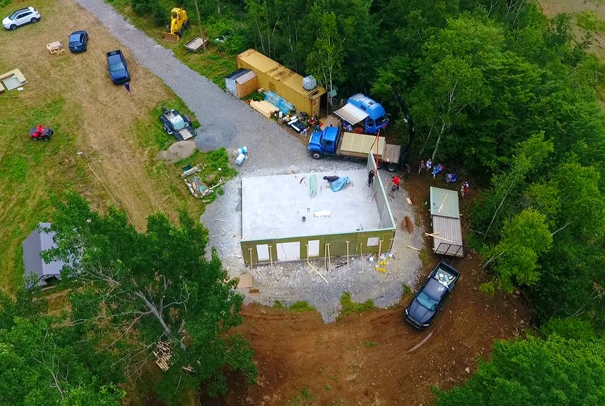 The walls starting to go up on the Gilbert's Cove home. The process of putting up the exterior walls and roof took roughly 12 hours. PHOTO COURTESY JD COMPOSITES