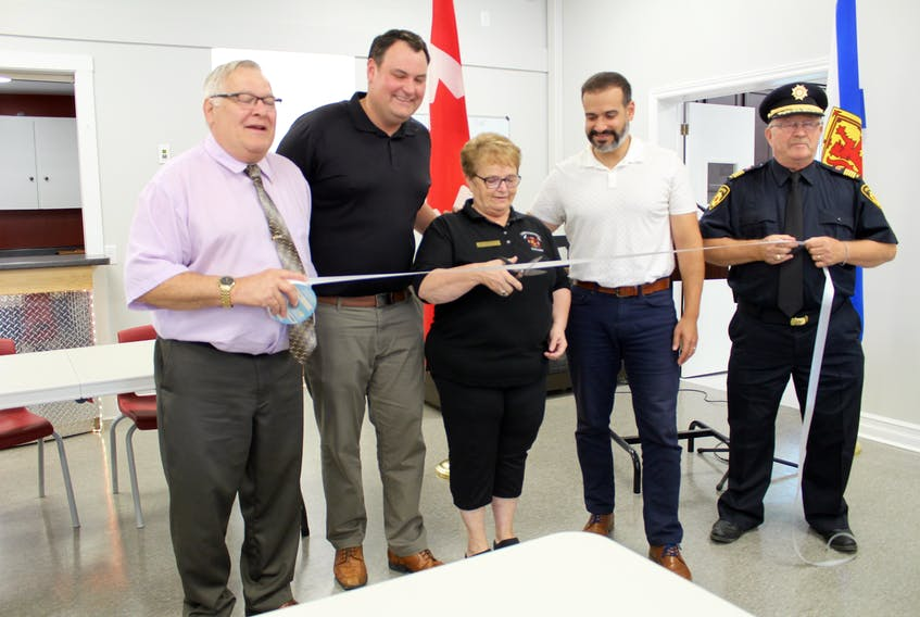 Cutting the ribbon at the Sept. 6 grand opening for the Lakes and District fire hall in Yarmouth County. From left: Yarmouth Warden Leland Anthony, West Nova MP Colin Fraser, Corinne Killam, president of the Lakes and District's auxiliary, Yarmouth MLA and provincial cabinet minister Zach Churchill, Lakes and District fire chief Scott Killam.