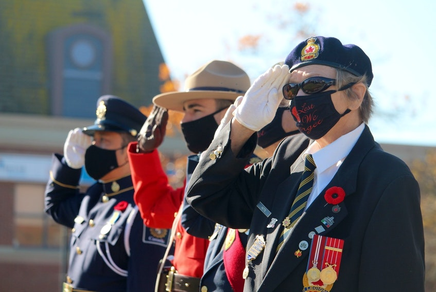 Standing at attention during the Remembrance Day service at the Yarmouth cenotaph.