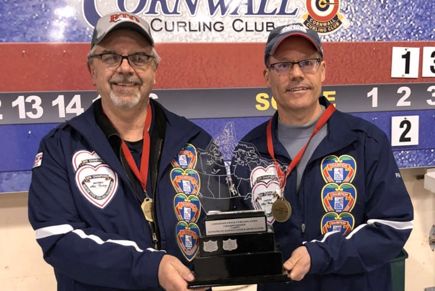 Dave McDougal and Paul Doucet, pictured after winning last year's national stick curling title in Cornwall, P.E.I., are the reigning Nova Scotia champs and will take part in the provincials to be held in Yarmouth Feb. 14-16.