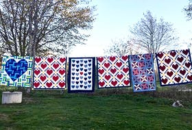 As the 430+ quilts arrived from across the nation over a nine-week period , the president of the Maritime Modern Quilt Guild hung them in groups on her clothesline to let quilters know their contribution had arrived safely.