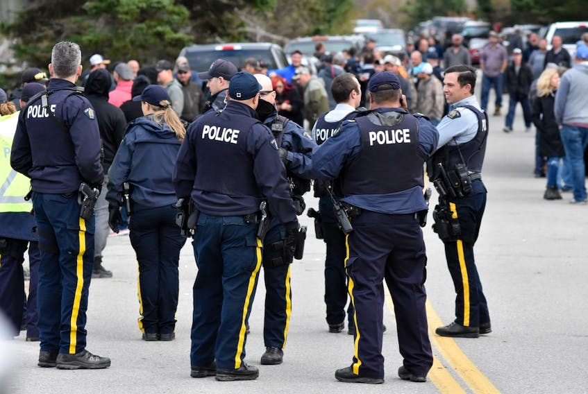 RCMP, commercial fishermen and First Nations fishermen at a blockade outside a New Edinburgh lobster pound on Wednesday.