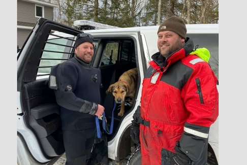 Nathaniel Denton and Mike Titus following their rescue of a dog that was stranded on the ice in Haines Lake, Digby County on Sunday, March 14. The neighbours rescued the dog via a canoe after breaking up ice to make a path to the animal. ZANE LYNCH PHOTO