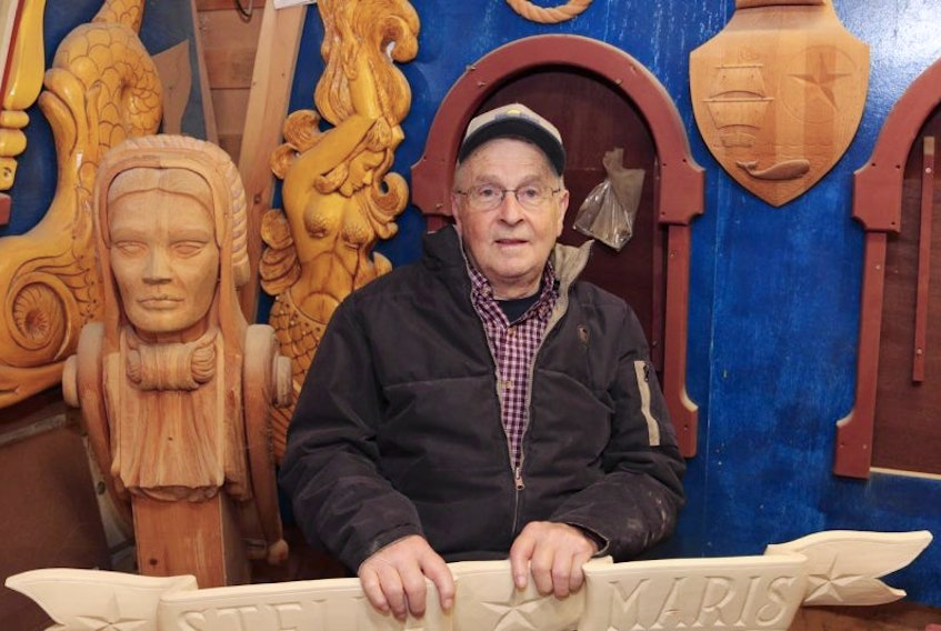 The late Jean Belliveau with ornate wood carvings he made for his 36-foot long replica of a Dutch sailing yacht - Stella Maris.  Karla Kelly File Photo