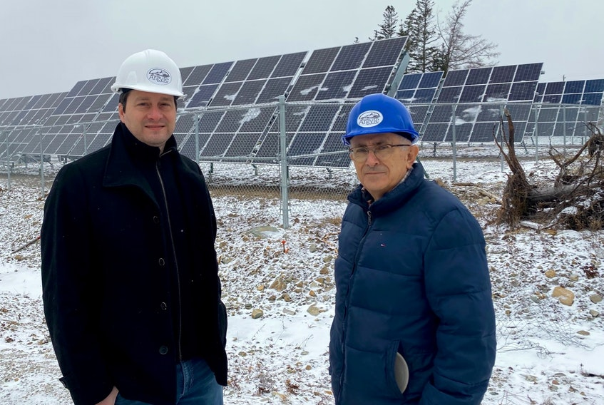 Municipality of Argyle CAO Alain Muise and Warden Daniel Muise predict the solar garden behind the newly constructed administration building could reduce  annual energy cost savings by $27,000.