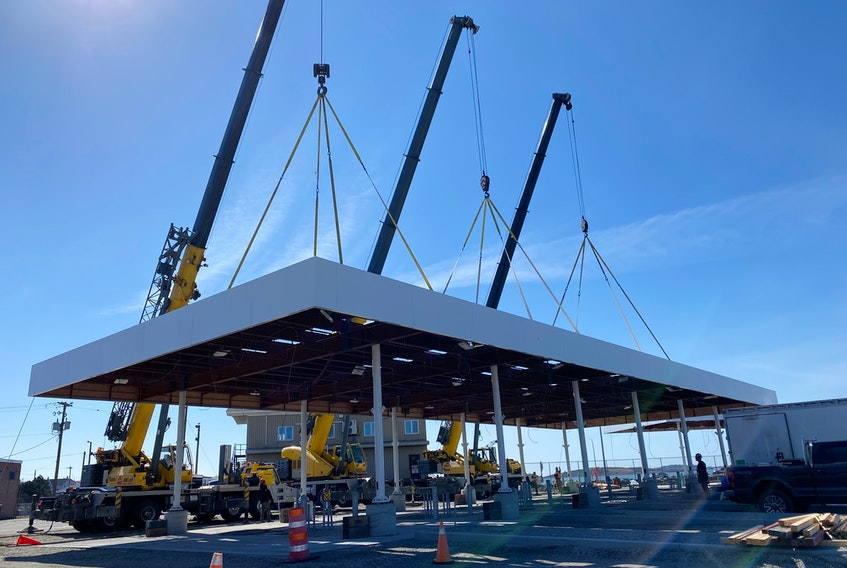 Three new canopies were erected on March 10 as part of the renovations at the Yarmouth ferry terminal. Crews will work through the coming weeks on electrical, lighting and soffits for the canopies which will provide cover for new booths once installed. CARLA ALLEN • TRICOUNTY VANGUARD