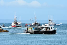 Boats from the Sipekne'katik First Nation leave the Saulnierville wharf with lobster gear aboard after the seven moderate livelihood licences and tags were given out. Also outside of the mouth of the harbour were dozens of commercial lobster vessels from LFA 34 who are protesting out-of-season commercial sales of lobster. TINA COMEAU PHOTO