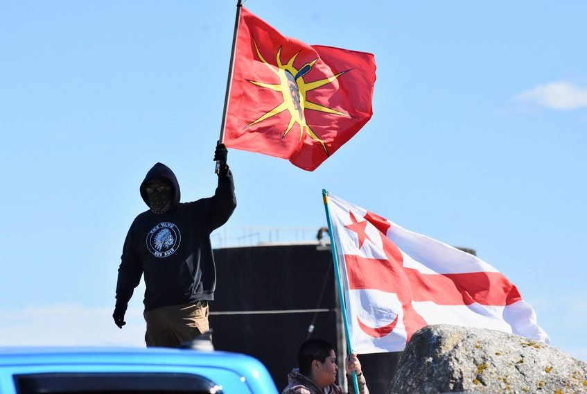 Flags are waved at the Saulnierville wharf to show pride and defiance for Treaty fishing rights. TINA COMEAU PHOTO