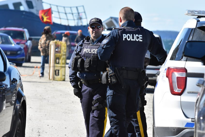 Members of the RCMP at the Saulnierville wharf on Saturday, Sept. 19. Sipekne'katik First Nation is exercising its Treaty right and conducting its own  moderate livelihood fishery from here that the commercial season calls unauthorized. The band had access to the wharf blocked off on the weekend to only its fishers and supporters. TINA COMEAU PHOTO