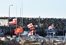 Flags flap in the wind from Sipekne'katik First Nation boats tied up at the Saulnierville wharf. TINA COMEAU PHOTO