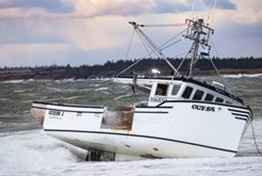 "The fishing vessel ""Guess' went aground west of Yarmouth Bar on Dec. 15. The five crew members made it safely to shore.  Ervin Olsen Photo"