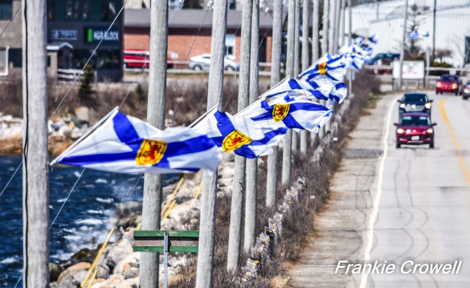 Nova Scotia flags mounted along the Cape Sable Island causeway in the Municipality of Barrington in honour of the lives lost during the April 18-19 mass shooting in the province. FRANKIE CROWELL PHOTO