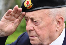 Korean War veteran Kenneth Jeffery salutes after a wreath is laid outside the Wedgeport Legion in Yarmouth County. Because of COVID-19 the veterans wore masks during the ceremony but removed them for this part of the ceremony. TINA COMEAU PHOTO