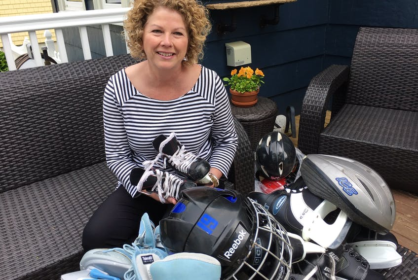 Kelly Goudey with some of the skates and helmets that have been donated so far for youth in the far-north hamlet of Cambridge Bay.