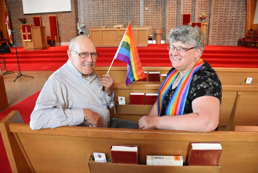 Jack Murphy and Reverend Sharon Lohnes sit inside Beacon United Church in Yarmouth. The church is in the process of becoming an affirming church that officially welcomes members of the LGTBQ community. TINA COMEAU PHOTO