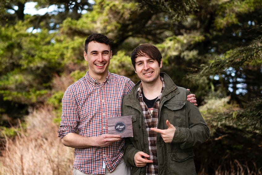Chad Comeau (left), game designer, and Marc d'Entremont, graphic designer, have teamed up to create À tchi?, a new Acadian card game based on old names and local tradition.