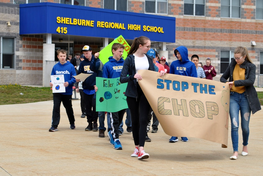 Students from Shelburne Regional High School and some community members participating in a May 3 walk aimed at drawing attention to clearcutting and climate change issues. KATHY JOHNSON PHOTO