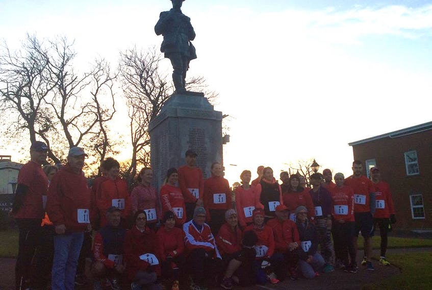 Participants in the Yarmouth Poppy Run at the cenotaph on the morning of the 2016 event. CONTRIBUTED PHOTO