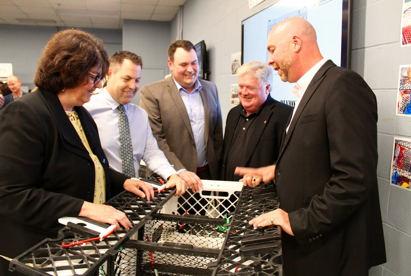 Checking out one of the Ignite Labs displays at NSCC Burridge Campus in Yarmouth on June 29 (from left): Mary Thompson, principal at NSCC Burridge; Doug Jones, founder and executive director of Ignite Labs Inc.; West Nova MP Colin Fraser; Jeffery Mullen, director of enterprise development with ACOA; Scott Dauphinee, managing director of The Lobster Trap Company.