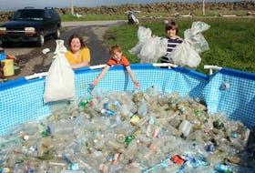 Rhynda, Ian and Brier Tudor from Brier Island have been filling a swimming pool with plastic bottles and other garbage they've collected while cleaning up the coastline around this part of Digby County.