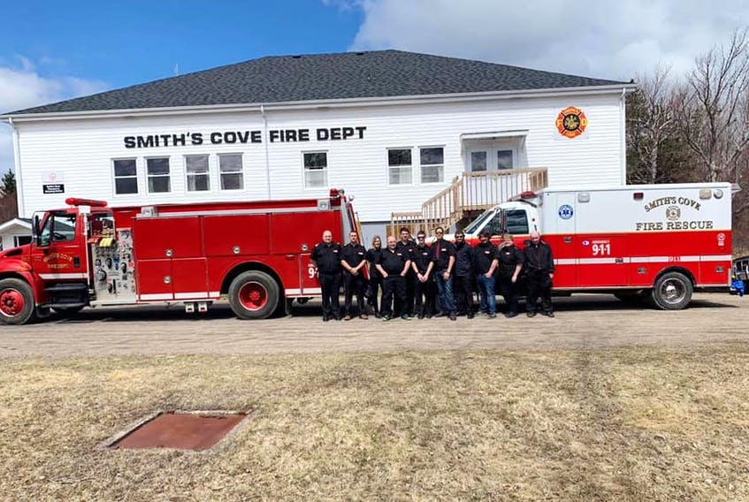Some members of the Smith's Cove Fire Department posing for a picture that was entered in the fire hall photo contest that is organized annually by AA Munro Insurance. Smith's Cove ended up winning the first prize of $5,000 after the Reserve Mines Fire Department – whose entry had seemed destined to win the contest – pulled out.