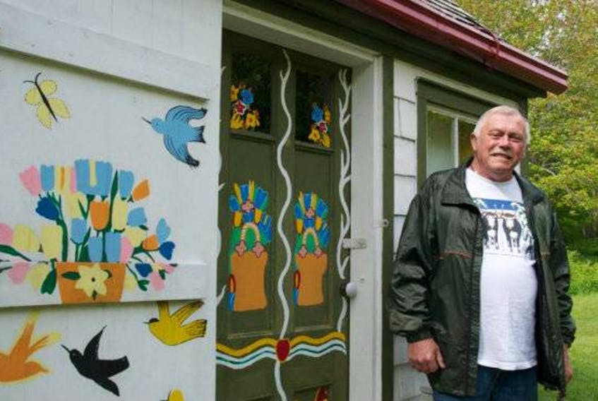 Murray Ross stands in front of his Maud Lewis replica house in Digby Neck. FILE PHOTO