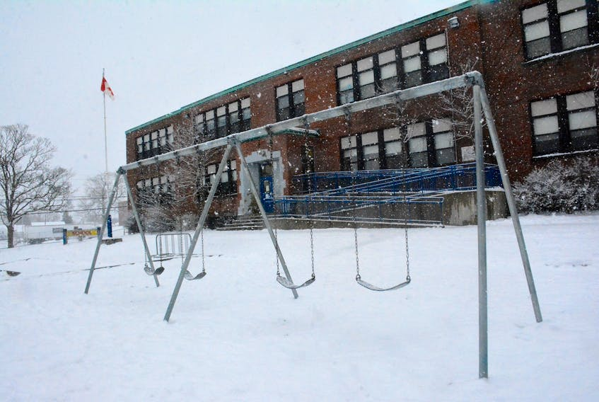 An empty Yarmouth Central School play yard and building after students had an early dismissal due to pending weather.