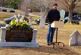 Reverend Ed Trevors says a few words during the unveiling of the new Alms House monument in the Pine Grove Cemetery on Nov. 14.