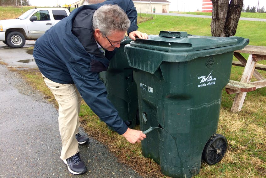 Gus Green, general manager of Waste Check, with an example of a damaged green cart. People who want to have their cart repaired or replaced can contact Waste Check, which serves Yarmouth and Digby counties.