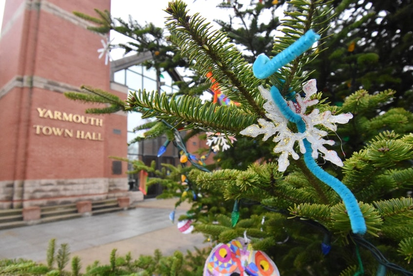Decorations made by children adorn the Christmas tree outside the Yarmouth town hall. There is much grief and heartbreak in this town following the death of a four-year girl after she fell beneath a float during the annual Christmas parade. TINA COMEAU