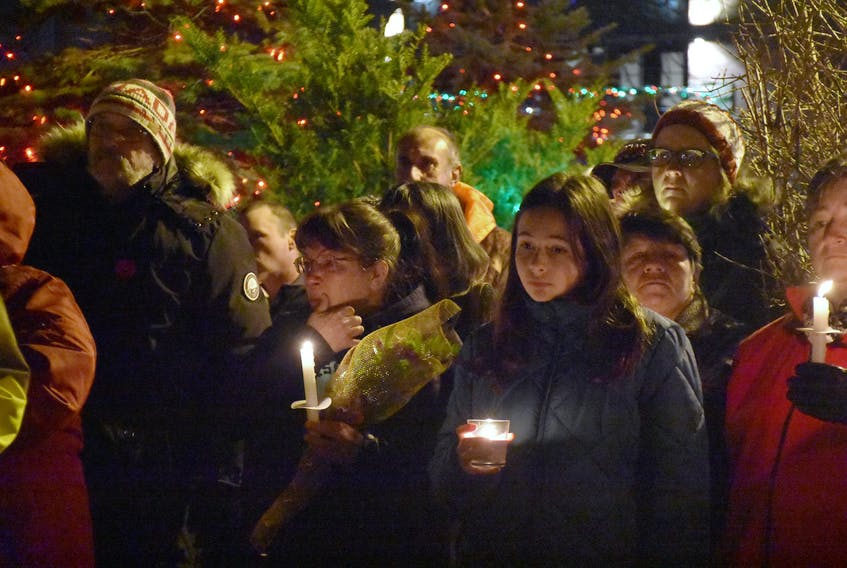In the wake of a tragedy that claimed the life of a four-year-old girl at Yarmouth's annual Christmas parade of lights, a candlelight vigil was held in Frost Park on Nov. 26. TINA COMEAU PHOTO