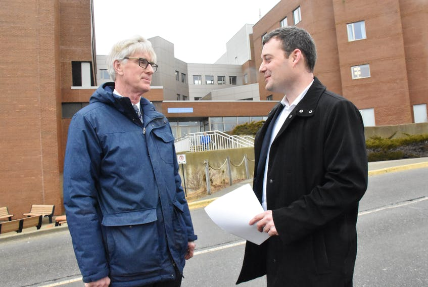 Dr. Drew Bethune, the medical director of Nova Scotia Cancer Care, and provincial Health and Wellness Minister Randy Delorey, stand outside the Yarmouth Regional Hospital on Jan. 30. They were in town to deliver the results of a cancer care review. TINA COMEAU
