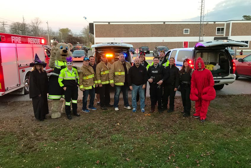 Emergency services and volunteers were at the fire hall parking lot in Shelburne Halloween night to hand out treats to trick-or-treaters.