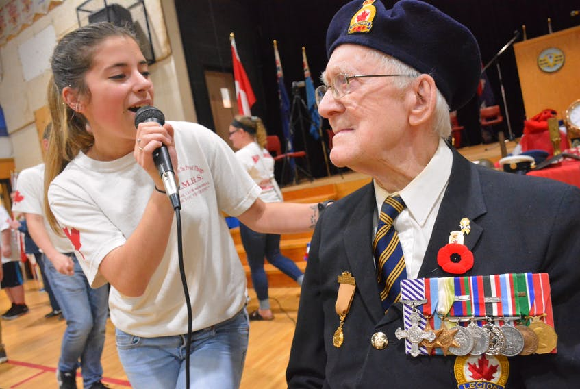 Britthany Pothier serenades Second World War veteran Jim McRae during a remembrance ceremony at Maple Grove, put on by the Maple Grove and Yarmouth High Memorial Clubs. McRae turns 100 years this month. TINA COMEAU PHOTO