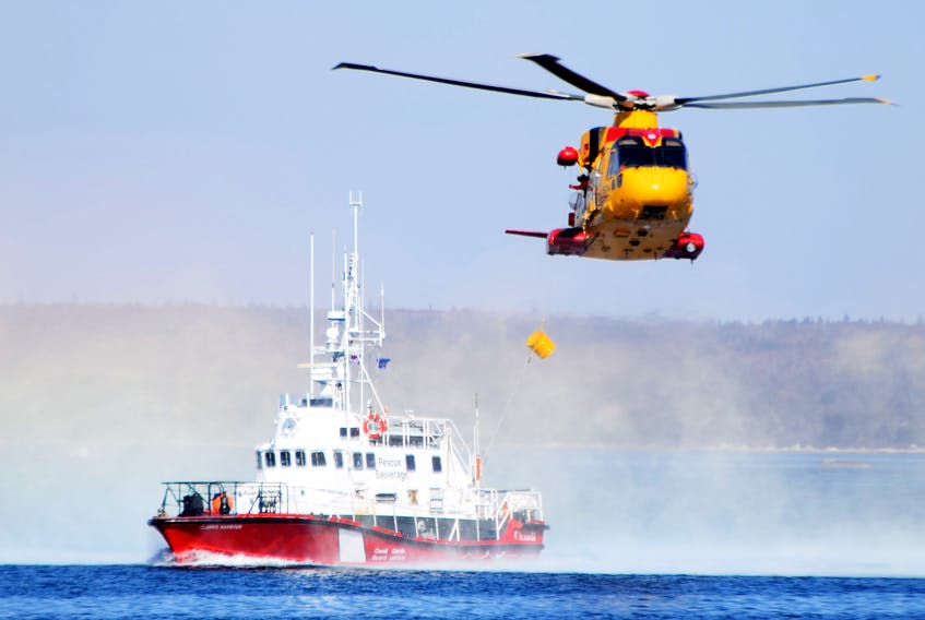 A Cormorant helicopter drops a pump to the Canadian Coast Guard cutter Clark's Harbour during a search-and-rescue exercise off West Head, Cape Sable Island, last fall.  KATHY JOHNSON