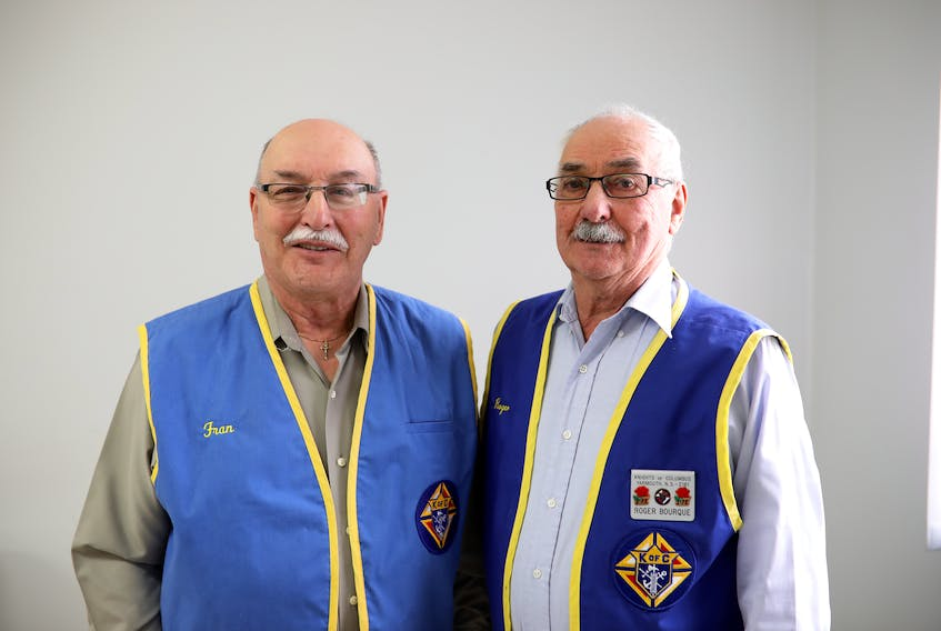 Yarmouth Knights of Columbus members Francis Albert (left) and Roger Bourque are two of the volunteers that install and service Northwood Intouch systems across Digby, Shelburne and Yarmouth counties. - Contributed