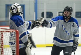 Southside MacDonald's Excavation/EF MacPhee Lynx  goalie Coulton Coles congratulates Nathan Paynter on his first period goal Monday during Game 1 of the Razzy's P.E.I. Junior C Hockey League at Cody Banks Arena.