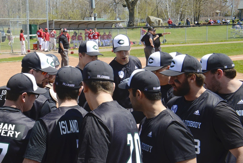The Charlottetown Gaudet's Auto Body Islanders prepare to take the field during a senior baseball game at Memorial Field this summer.