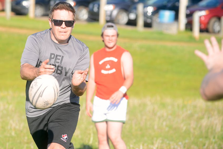 Shaun Younker of the Hunter's Ale House Mudmen Old Boys passes the ball to a teammate during Tuesday's practice at Co-op Field in Charlottetown.