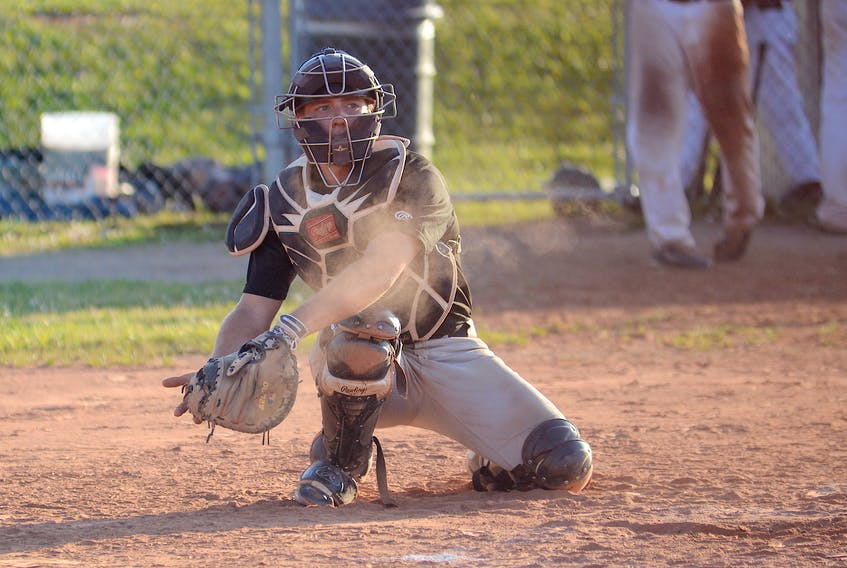 Cole MacLaren catching in the Kings County Baseball League during the 2017 season with the Morell Chevies.