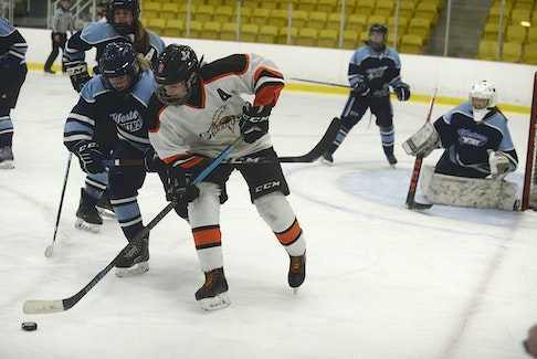 Western Wind's Chloe Gallant, left, tries to tie up Central Storm's Abby Gordon during the first period of Saturday's P.E.I. Under-18 Girls Hockey League final at MacLauchlan Arena in Charlottetown.