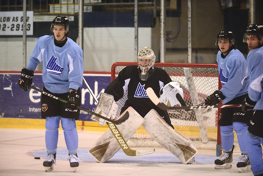 Goalie Colten Ellis prepares for a shot from the blue-line Tuesday during the Charlottetown Islanders' first practice of the season at the Eastlink Centre. Looking for a tip or a rebound are, from left, Justin Gill, Cedric Desruisseaux and Patrick LeBlanc.