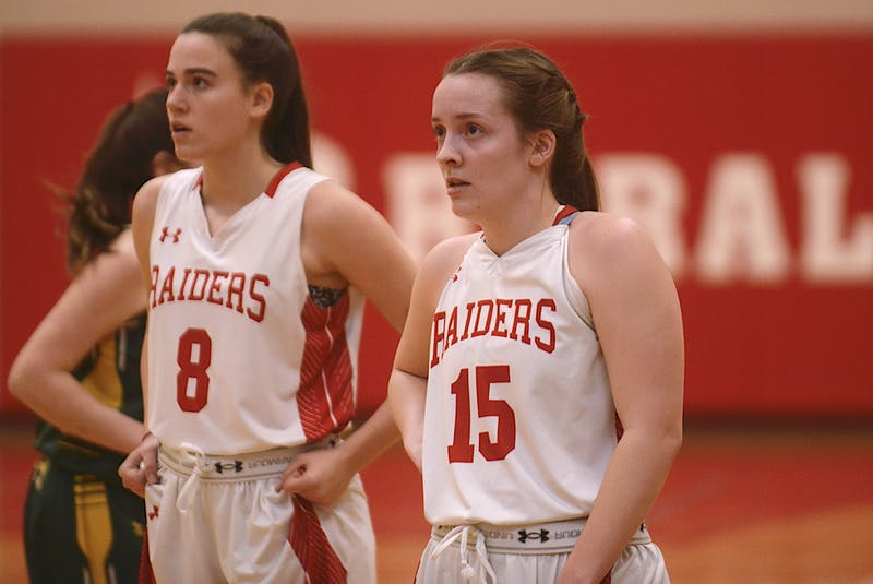 Charlottetown Rural's Amy Plaggenhoef, right, completed her high school basketball career recently with a third provincial senior AAA banner. - Jason Malloy