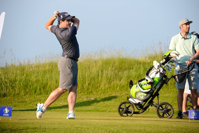 Charlottetown's Curtis Hall watches his tee shot Friday from the first hole at Eagles Glenn of Cavendish.