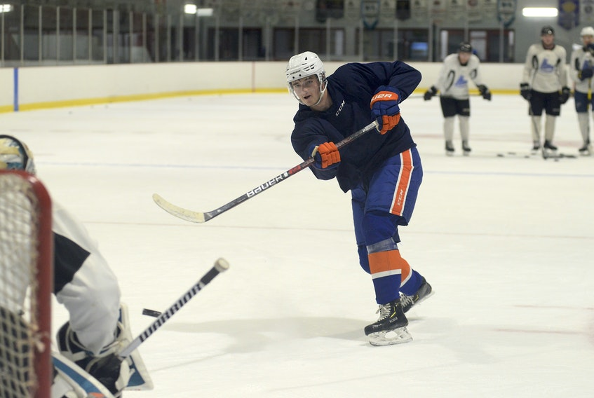 Summerside's Noah Dobson fires a shot on Antoine Bibeau during a recent skate at the Pownal Sports Centre.