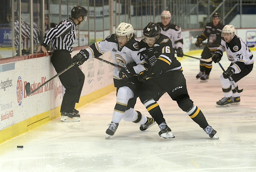 Cape Breton Eagles centre Félix Paré, right, and Charlottetown Islanders defenceman Will Trudeau battle for the puck Saturday during Quebec Major Junior Hockey League action at the Eastlink Centre.