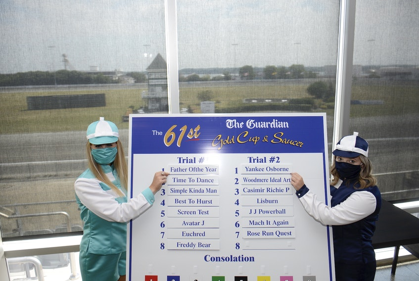 Ambassadors Whitney Smith, left, and Karley Affleck helped with Tuesday's draw for The Guardian Gold Cup and Saucer. The 15-horse field is divided into two trials, which will take place Saturday and Monday at Red Shores at the Charlottetown Driving Park.