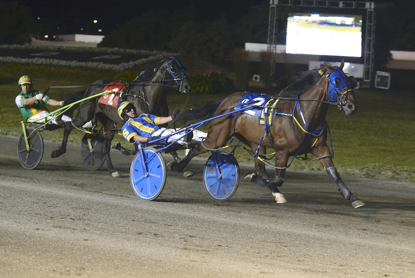 Bugsy Maguire, with Austin Sorrie in the sulky, leads Euchred (Jody Jamieson) to the finish line Saturday night at Red Shores at the Charlottetown Driving Park. Bugsy Maguire won the birthplace of confederation series final in 1:53.2 for owner Walter Simmons of Summerside. Euchred (1:53.4) finished second while Woodmere Ideal Art (1:54) was third.